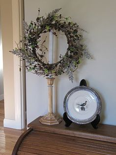 wreath wired to an old lamp stand