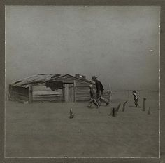 Farmer and sons walking in the face of a dust storm. Cimarron County, Oklahoma. Arthur Rothstein, 1936.
