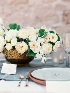 Creamy white garden Roses arranged in an antique bronze bowl. #wedding #flowers