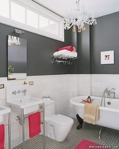 dark grey walls, white furniture and pink towels