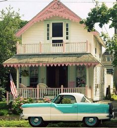 Great house and cute Nash. That's a Nash Metropolitan. My dad had one of these, too. His was yellow and white.  The house behind it is really cute, too. Kinda goes with the car!