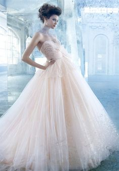 Tulle ball bridal gown, chantilly lace draped bodice with lace peplum, sweetheart neckline, natural waist accented with horsehair sash, sweep train. Lazzaro.
