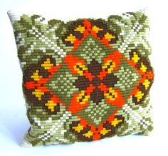 I'm a huge fan of mid-century needlepoint pillows.