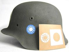 Chinese KMT (Kuomintang of China), stencil used on M35 German Helmets supplied to the Chinese by the Germans and painted generally by the Germans before shipping to Japan.  There are some with decals but the vast majority are stencils, just like our accurate version. Used in the Sino-Japanese War, China at that time having a close relationship with Germany. www.warhats.com