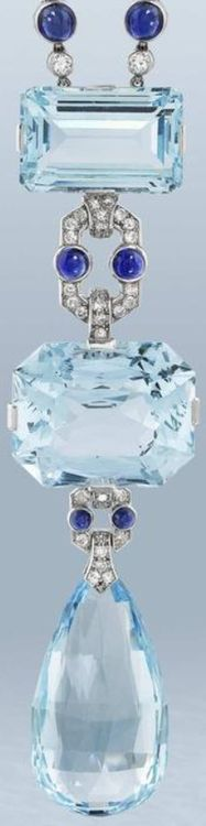 A fine aquamarine, sapphire and diamond sautoir, by Cartier, circa 1920.     The vertically aligned pendant set with two step-cut aquamarines, the largest cut-cornered stone to the centre, connected by cabochon sapphire and brilliant and single-cut diamond geometric links, terminating in an aquamarine briolette drop, suspended from a woven cord necklace with four rose-cut diamond finials, unsigned, necklace length 62.0cm., Cartier fitted case is a modern replacement. Via Bonhams.