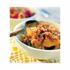 "Nutty Apple Crisp | ""Lovely tart apples are sliced up and arranged in a baking dish with lemon juice and water. Sprinkled on top is a delicious crumble topping made of oats, brown sugar, a bit of flour, butter, and chopped walnuts. And then the crisp is baked until the apples are tender and the top lightly browned."""