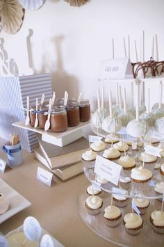 blue brown christening party dessert table for twin boys cupcakes