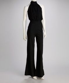 Take a look at this Black Wide-Leg Halter Jumpsuit by Costa Blanca.