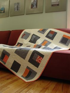 Gray and orange modern quilt. Love the color choices.