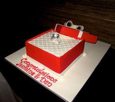 Engagement ring box cake..... The bride to be's favorite - red velvet. Covered in buttercream fondant.