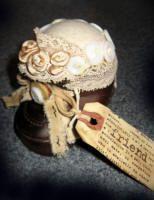 Baby shoe pincushion