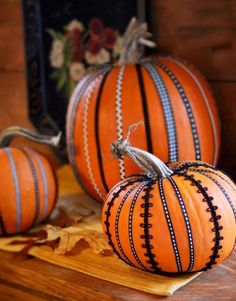 Ribbon on Pumpkins (if only the pumpkins wouldn't go bad before the IFC Thanksgiving Dinner like last year!) 45 Pumpkin Decorating Projects | Midwest Living