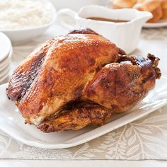 Our Turkey-in-a-Bag is moist, flavorful, and has the caramel tone of a roasted turkey. How do we keep it that way? A soy sauce paste helped the turkey golden and an aluminum foil and cheese-cloth protective shield kept our turkey breasts tender.