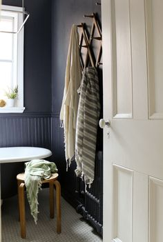 Love the wall colour, and the  vintage accordion rack.