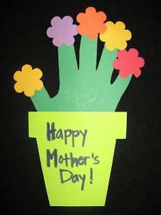 """These """"Hand Print Flower Pots"""" are a cute project for Mother's Day.  I would have my students write adjectives about their mothers in the flower and/or stem areas."""