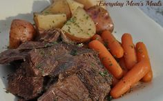 ~Slow Cooker Pot Roast~ Comfort food at it's best. Tender meat, flavored to perfection with veggies too, making this a full meal that is cooked for you on a busy day!