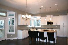 Liberty Homes Aspen floor plan, open over-sized kitchen, custom white