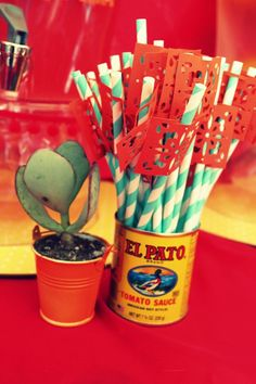 Summer Fiesta with a contemporary Mexican twist...papel decorations on old fashioned straws