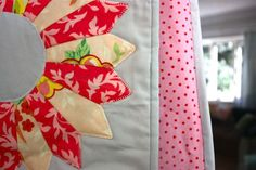 Pretty bright colors on grey backgroud quilt with applique blanket stitch