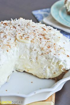 Vanilla Coconut Banana Cream Pie Recipe ~ Says: Sky-high banana cream pie made with a vanilla filling and topped with toasted coconut, this easy pie is sure to impress! cake, cream pies, coconuts, food, vanilla coconut, pie recipes, coconut banana, banana cream, dessert