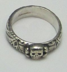 "The Totenkopfring (Skull Ring, Death Head Ring) that was awarded to select SS members directly from Himmler. The ring was obtained by the SS member after careful screening as a ""Sign of our loyalty to the Führer, our unwavering obedience to our superiors and our unwavering solidarity and camaraderie."" The award certificate was signed by Himmler himself. Originally created for a maximum 5,000 SS, the ring was later granted to any SS ""worthy"" of the award."