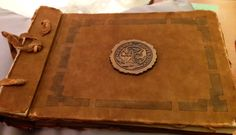 Scrapbook with original charter of Purdue University chapter of Mortar Board National College Honor Society dated 1926.