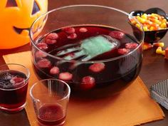 Fill a plastic glove with colored water and freeze put in drink bowl. I am so doing that for my Halloween party