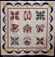 """Album Quilt by Louise Robertson, quilted by Karolyn """"Nubin""""Jensen.  Photo by Quilt Inspiration."""