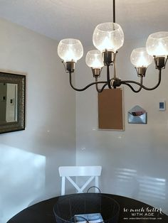 """Jamie of """"So Much Better With Age"""" used one of our Feiss chandeliers over her kitchen table. See more details here: http://www.somuchbetterwithage.com/2014/11/kitchen-chandelier-in-the-rustic-cabin/"""