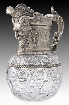 Gorham Manufacturing Company of Providence, R.I. (1831–present), won 30 awards in the gold and silverware category at the World's Columbian Exposition in Chicago in 1893, which celebrated the 400th anniversary of Christopher Columbus's discovery of America. This glass wine pitcher with silver gilding measures 12 by 9 by 7 inches and depicts a satyr on the spout with bacchantes amid clusters of grapes.