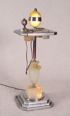Art Deco smoking stand.  The piece that looks like a microphone is an electric cigarette lighter. @Deidré Wallace