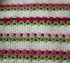 A crochet- along tutorial on The Flowers in a Row/ Tulip throw blanket play list by Bethintx1