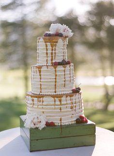 Cake topped with fruit and caramel, photo by Bret Cole http://ruffledblog.com/lake-tahoe-wedding-inspiration #weddingcake #cakes