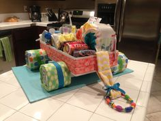 Wagon Diaper Cake in a colorful jungle theme for a baby boy