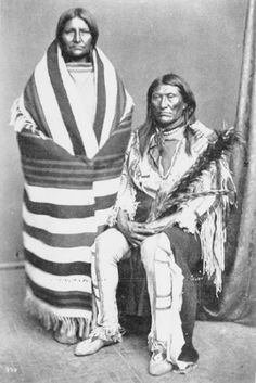 Kam-ne-but-se (aka Black Foot, aka Sits In The Middle Of The Land) and his wife - Crow - 1873