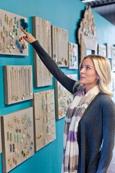 I have no idea who this is but I love the idea of displaying jewelry on canvases!