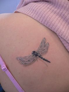 A dragon fly woman tattoo