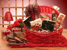 """I'm sweet on you this Valentines day! A classic red basket filled to overflowing with delicious chocolate treats will delight youth valentine this year!    """"14"""""""" Gloss Red basket   7 oz caramel filled chocolate hearts   4 Pc assorted nuts and chews chocolates   Chocolate cappuccino malt balls   4 pc coconut cream chocolates   Chocolate fudge popcorn   Chocolate fudge brownies   Foil wrapped chocolate message hearts Creamy chocolate fudge SHOP NOW: www.Kimslabellabaskets.com"""