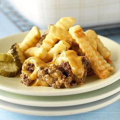 Cheeseburger and fries casserole  2 pounds lean ground beef  1 10 3/4 - ounce can condensed golden mushroom soup   1 10 3/4 - ounce can condensed cheddar cheese soup   1 20 - ounce package frozen, fried crinkle-cut potatoes  Hamburger toppings (choose from catsup, pickles, mustard and chopped tomato)