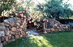 Blooming roses cover this iron trellis with spring and summer cheer. From Drake Design Associates - Landscape Design Studio.