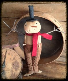 Primitive Snowman...with an old scale & grain sieve.