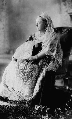 Queen Victoria poses for a photograph for her Diamond Jubilee, celebrating her 60th anniversary as queen.  Notice she wears lace made for her wedding day over her black mourning dress as a tribute to her late husband, Albert.  The queen never again wore colors after the prince consort's death on December 14th, 1861.