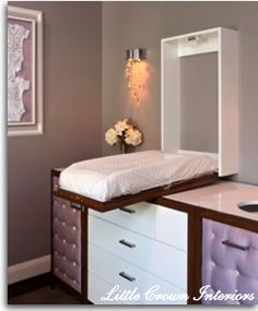 When you fold the changing table up, it is just a mirror on the wall (the mirror is on the back side of the changing table). What a good way to hide the changing table!