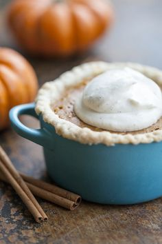 mini individual pumpkin pies with vanilla whip cream...this looks so yummy!! Must try soon!