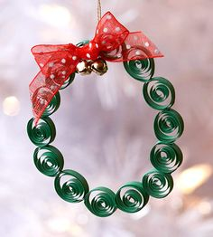 Quilled Wreath - use tiny, precut strips of paper, or cut your own paper to the width you like.
