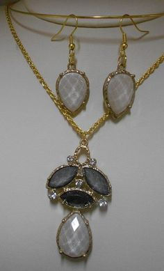 'Elegant Pendant and Earrings Set' is going up for auction at 12pm Mon, Nov 12 with a starting bid of $15.