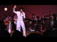 Elvis kidding around on stage