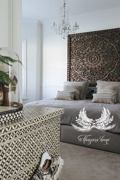 Manyara Home - Bedroom Minus the chandelier, I love this. That wooden wall art makes me happy