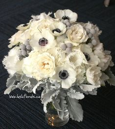 love this for winter. white hydrangea, spray roses, fringed tulips, anemones, with accents of silver brunia and dusty miller.