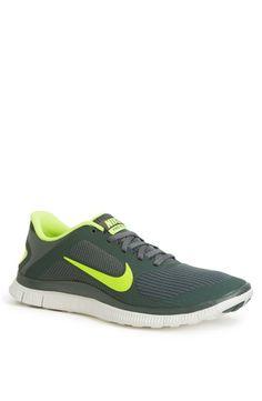 Neon Nike Free men's running shoe.